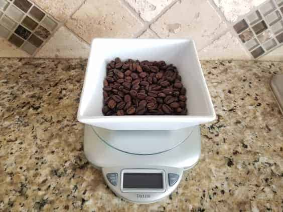 Coffee beans being weighed