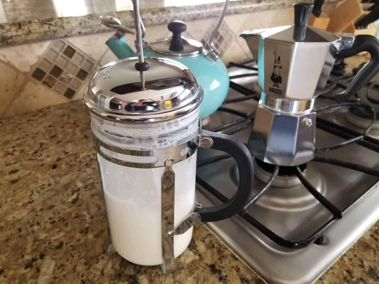 Frothing milk with a French press